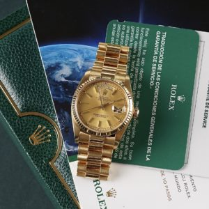 Rolex Oyster Perpetual Day-Date Reference 18038 from 1982 including box and service papers. The Day-Date measures a 18k Yellow Gold case (36mm), 18k Yellow Gold President bracelet with concealed crownclasp and fluted 18k yellow gold bezel. The Day-Date 18038 features an automatic Cal. 3055 Quickset date function, champagne colored tritium dial and scratch resistance sapphire crystal. Every watch sold by Langedyk Vintage Watches is included with a LVW watch box, Authenticity report and free worldwide (insured) shipment. In addition, every pre-owned watch is offered with our 12-month warranty from the date of purchase.